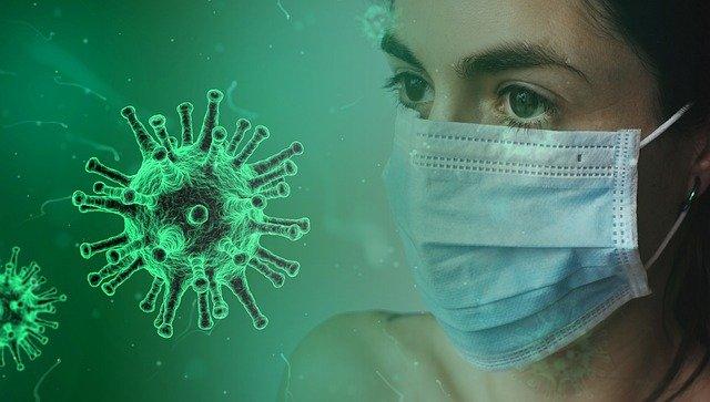 マスクをする女性とウイルス
